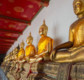 Row of buddha statues in Wat Po temple — Stock Photo