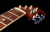 View down the fretboard of guitar — Stock Photo