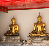 Pair of buddha statues in Wat Po temple — Stock Photo