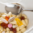 Stock Photo: Vitamins in bowl of tablets