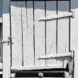 Old white wooden barn door - Stock Photo