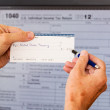 USA tax form 1040 for year 2012 and check — Stock Photo