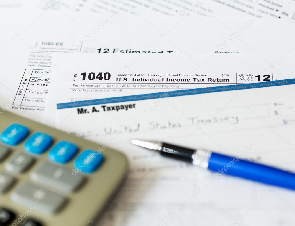 Tax form 1040 for tax year 2012 for US individual tax return with pen and check — Stock Photo #12393354