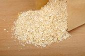 Oat bran in a paper bag — Stock Photo
