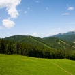 Beautiful blue sky and rock high up in Carpathian mountains. — Stock Photo