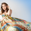 Stock Photo: Portrait of the young beautiful girl in colorful dress.