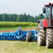Ploughing tractor at field cultivation work — Stock Photo #11049968