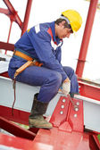 Builder millwright worker at construction site — Stock Photo