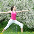 Young woman doing stretching exercises outdoors — ストック写真