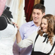 Stock Photo: Young peoples shopping at clothes store