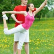 Young woman and instructor doing exercises — Foto de Stock