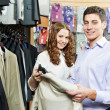 Royalty-Free Stock Photo: Young peoples shopping at clothes store