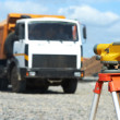 Surveyor equipment level at construction site — Stock Photo #11050304