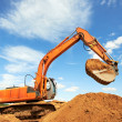 Track-type loader excavator at work — Stock Photo #11050377