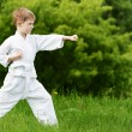 Постер, плакат: Little boy make karate exercises