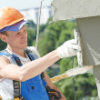 Facade builder plasterer at work — Stockfoto