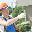 Stock Photo: facade builder plasterer at work
