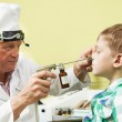 Little boy at ear nose thoat doctor — Stock Photo #11102536
