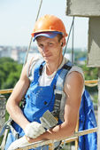 Facade builder plasterer at work — Stock Photo