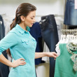 Young woman at shirts clothes shopping — Stock Photo