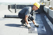 Flat roof covering works with roofing felt — ストック写真