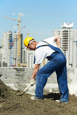 Worker roofer with shovel — Foto Stock