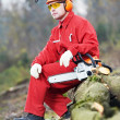 Stock Photo: Lumberjack Worker With Chainsaw In Forest