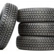 Stack of four car wheel winter tires isolated — Stock Photo #11181390