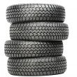 Stack of four car wheel winter tires isolated — Stock Photo #11181420