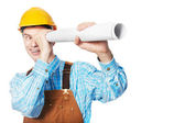 Happy worker in hardhat and overall with drafts — Stock Photo