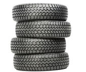 Stack of four car wheel winter tires isolated — Stock fotografie