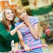 Two shopping woman with cart at supermarket — Stock Photo #11237808