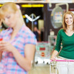 Women at supermarket shopping — Stock Photo