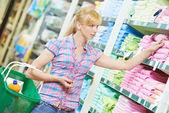 Shopping woman at household good supermarket — Stock Photo
