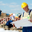 Engineer builders at construction site with draft - Stock Photo