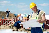 Engineer builders at construction site with draft — Stock Photo