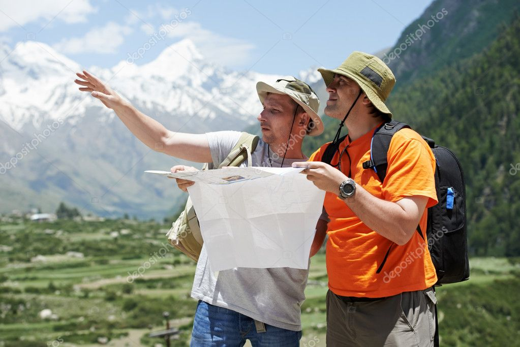 Two tjourist trvellers discussing route with map in Himalayas mountains  Stock Photo #11709956