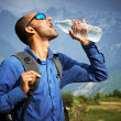 Thirsty tourist drink a water — Stock Photo