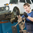 Stock Photo: Auto mechanic at work with wrench spanner