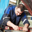 Stock Photo: Auto mechanic at car engine repair work