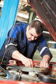 Auto mechanic at car engine repair work — Stock Photo