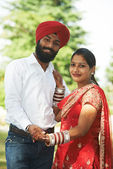 Happy indian young adult married couple — ストック写真