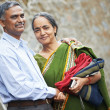 图库照片: Happy indian adult couple