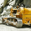 Track-type loader bulldozer excavator at road work — Stock Photo