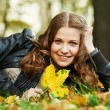 Woman at autumn outdoors — Stock Photo