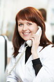 Pharmacy chemist woman in drugstore with phone — Stock Photo