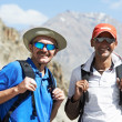 Two smiling tourist hiker in india mountains — Stock Photo