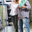 Young couple at clothes shopping — Stock Photo #12342640
