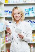 Happy Pharmacy chemist woman in drugstore — Stock Photo