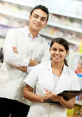 Two Pharmacy chemist in drugstore — Stock Photo
